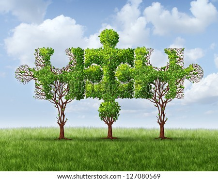 Growing network connection with a group of three trees in the shape of jigsaw puzzle pieces united and meeting together to form a strong stable financial team and business partnership based on trust. - stock photo