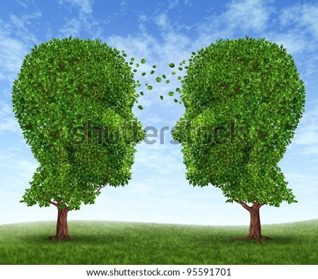 Growing partnership and teamwork communication in business with two trees in the shape of human heads on a blue sky with leaves exchanging from one face to the other as a concept of cooperation. - stock photo
