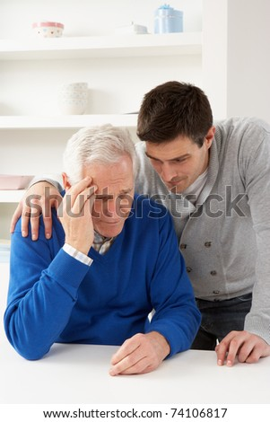 Grown Up Son Consoling Senior Parent - stock photo