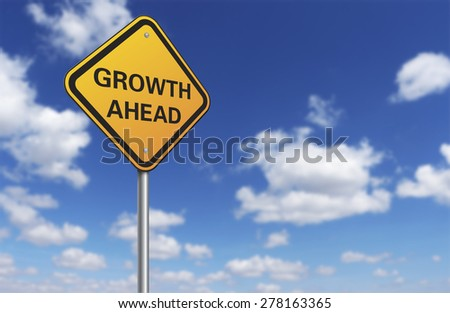 growth ahead road sign and blue sky - stock photo