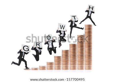 Growth - Business man happy  jumping or running on the money step and holding billboard with growth text - stock photo