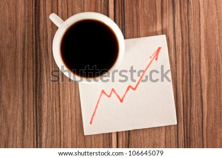 Growth chart on a napkin and cup of coffee - stock photo