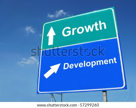 GROWTH--DEVELOPMENT road sign - stock photo