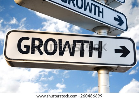 Growth direction sign on sky background - stock photo