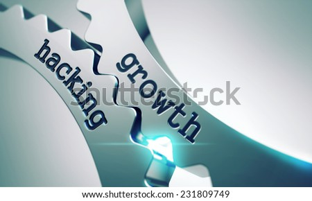 Growth Hacking on the Mechanism of Metal Cogwheels. - stock photo