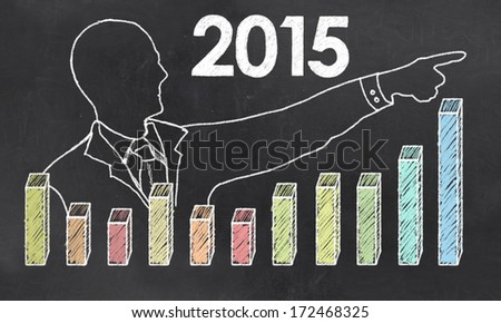 Growth in 2015 with Creative Businessman showing Positive Graph - stock photo