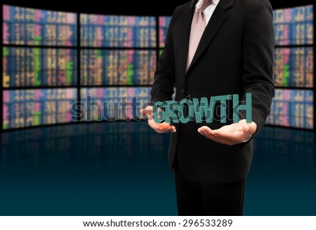 Growth text on hands businessman. - stock photo