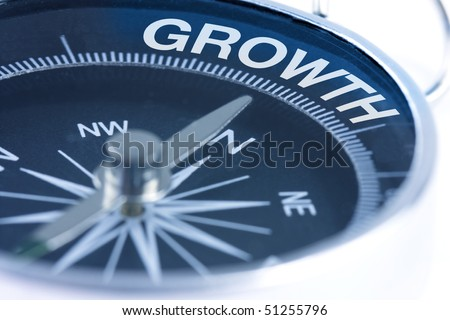 growth word on compass showing direction concept - stock photo