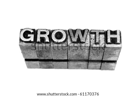 GROWTH written in metallic letters on a white background - stock photo