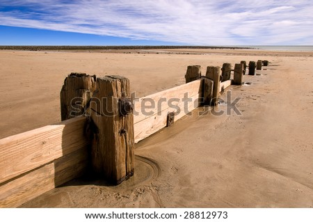 Groynes (Sea defences) on Alnmounth beach, Northumberland, UK - stock photo