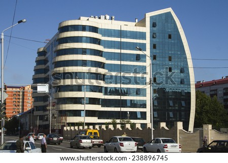 GROZNY, RUSSIA - SEPTEMBER 6: Modern business center with a glass facade on September 06, 2014 in Grozny. - stock photo