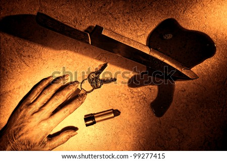 Gruesome murder crime scene of dead woman hand and dropped victim keys and lipstick tube with bloody kitchen knife weapon in pool of blood on floor as forensic criminal evidence in rough grunge sepia - stock photo