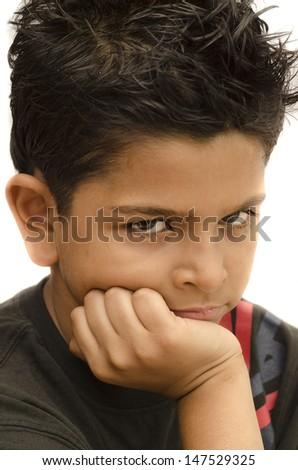 grumpy Asian boy staring at you - stock photo