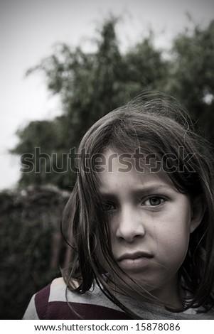 Grumpy Looking Child - stock photo