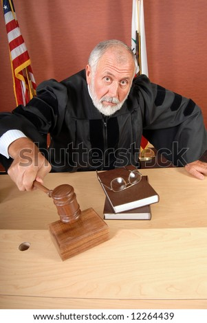 Grumpy old judge ruling during a trial in his courtroom