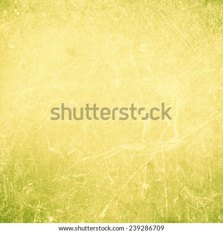Grunge Abstract yellow  textured  background with spotlight and scratches. Yellow grunge wall closeup for design. Grungy  backdrop.  - stock photo
