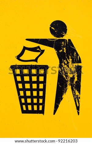 grunge and dirt textured trash bin sign on yellow