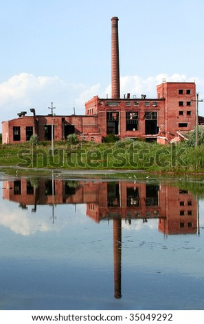 Grunge and old broken factory reflection - stock photo