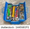 Grunge and old hand tools in old blue metal box - stock photo