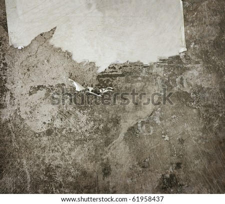 Grunge Background. Aged wall with a scrap of paper - stock photo