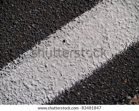 grunge background - asphalt road marking out - stock photo