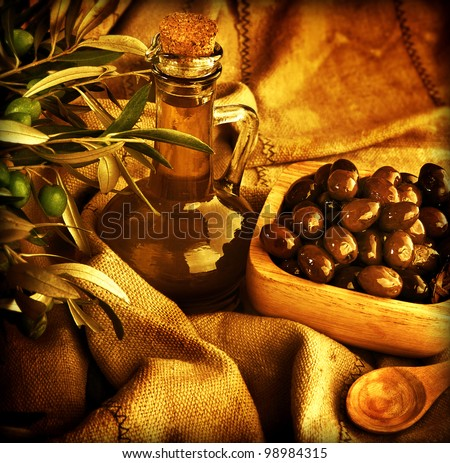 Grunge background, food still life, old style image of olives and olive oil, homemade traditional Mediterranean salad dressing, harvest - stock photo