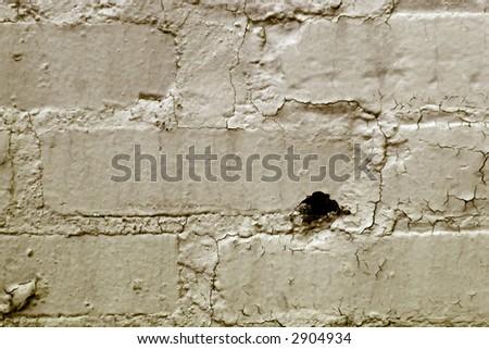 grunge background peeling plaster on brick wall - stock photo