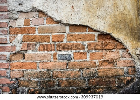 grunge background, red brick wall texture bright plaster wall and blocks road sidewalk abandoned exterior urban background  - stock photo