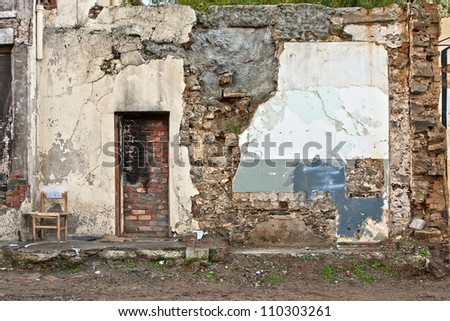 grunge background texture of demolished building showing scarred walls and door