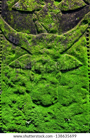 grunge background with bull head carved on stone - stock photo