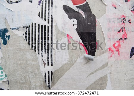 grunge background with old ripped posters  - stock photo