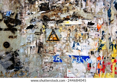Grunge Background with Old Torn Posters - stock photo