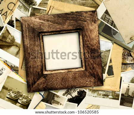 Grunge background with old wooden frame and photos - stock photo