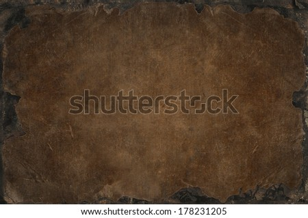 Grunge background with shabby, tattered, bleached fabric texture with rusty iron frame