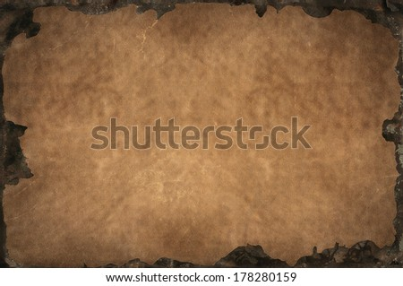 Grunge background with shabby, tattered, bleached leather texture with rusty iron frame - stock photo