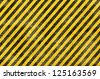 Grunge background, yellow and black stripes - stock vector