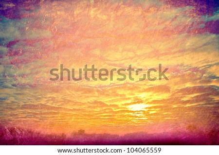 Grunge background.  Yellow clouds on sunset. - stock photo