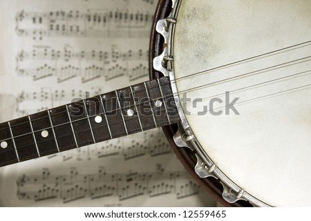 grunge banjo with score background - stock photo
