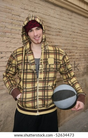 grunge basket ball street player on brickwall with cup - stock photo