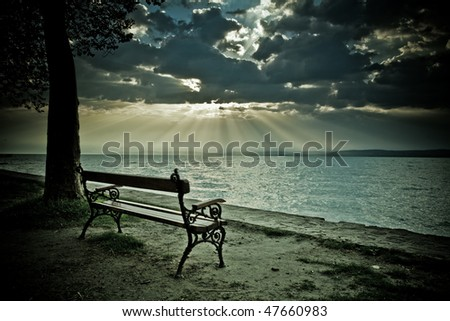 grunge bench with sun ray - stock photo