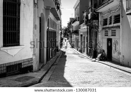 Grunge black and white image of a shabby street in Havana - stock photo