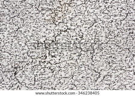 Grunge black cracks on white paint texture. - stock photo