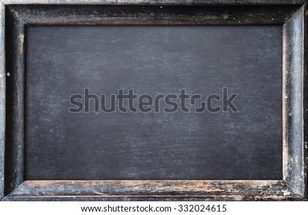 Grunge blank old wood black board or dirty slate board. Food Menu, List, Calendar, Classroom, Training, Remind, Drawing, Preaching, Brainstorm, Beginning, New, Start, Homework, Teachers Day concept. - stock photo