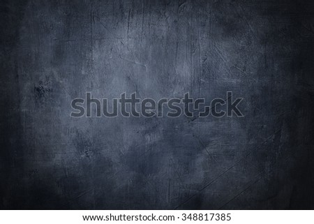 grunge blue background or texture with dark vignette borders
