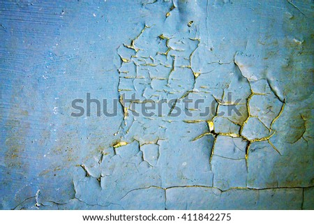 Grunge blue cracked dirty wall