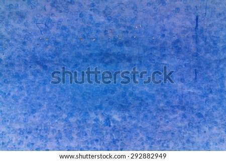 Grunge blue plaster walls and trace of tennis balls.Used film filter. - stock photo