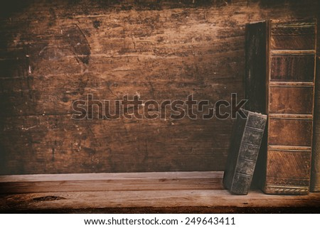 grunge books on wooden shelf with space for your background. - stock photo