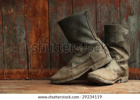 grunge boots on wood background