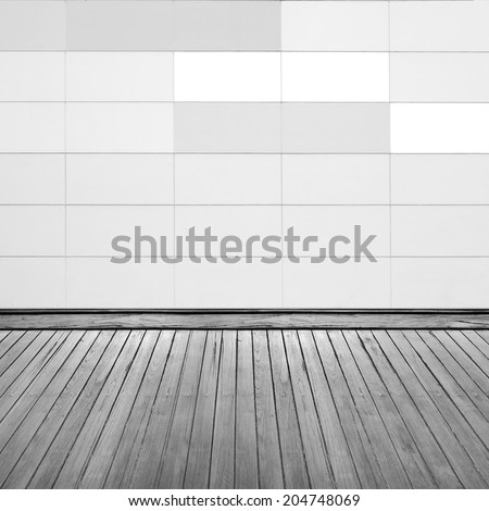 Grunge brick wall and wooden floor inside room. - stock photo