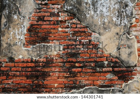 Grunge brick wall with cracked cement texture - stock photo